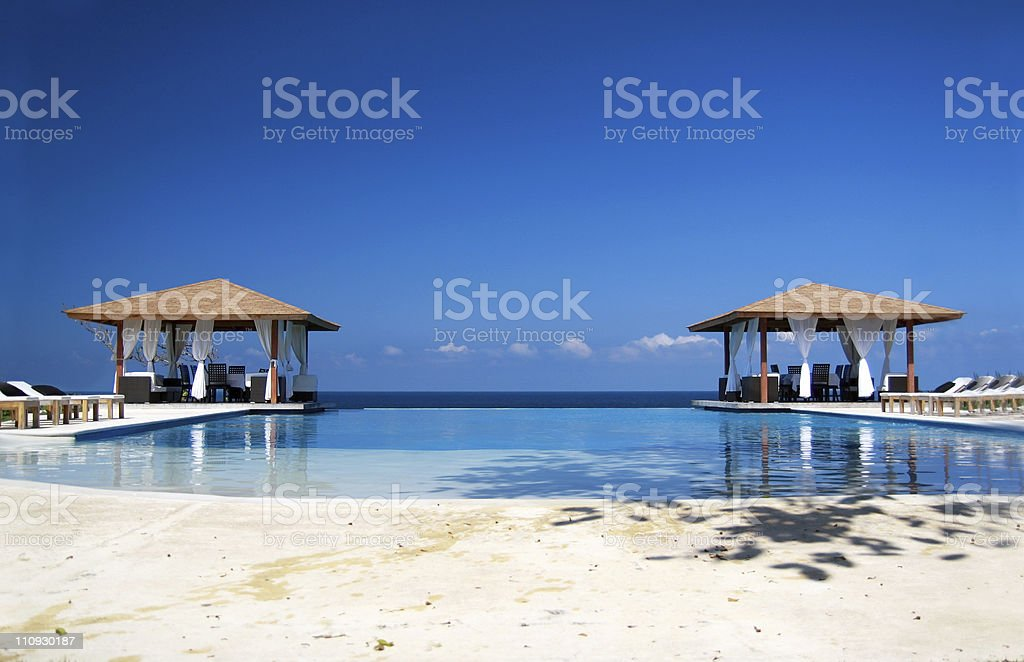 Two summerhouses in Caribbean paradise royalty-free stock photo