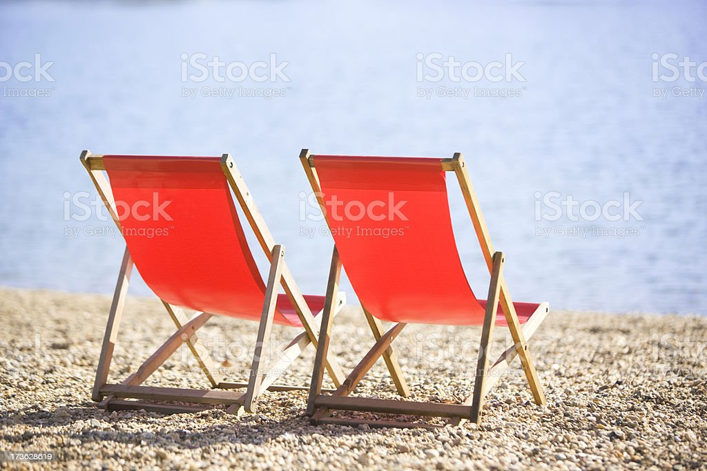 Two sun loungers stock photo