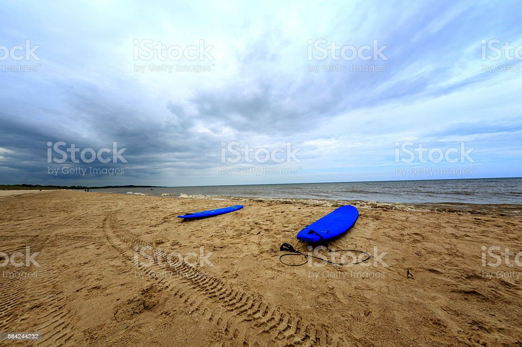 Two surfboards on the beach stock photo