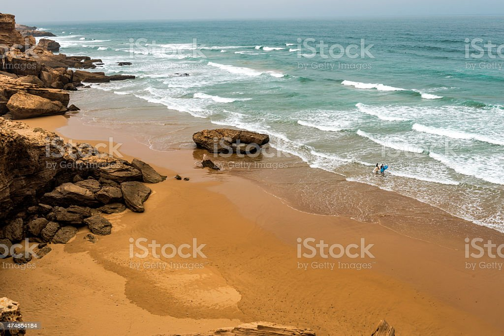 Two Surfers on Atlantic Coast, Sidi Ifni, Morocco, Africa stock photo