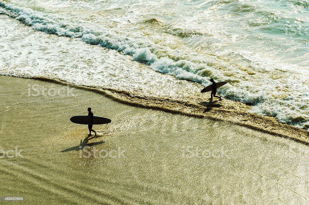 Two surfers stock photo