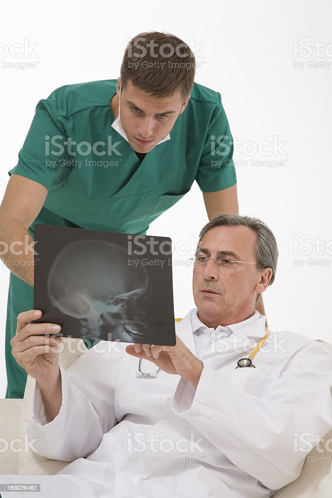 Two surgeon talk it over a radiography stock photo