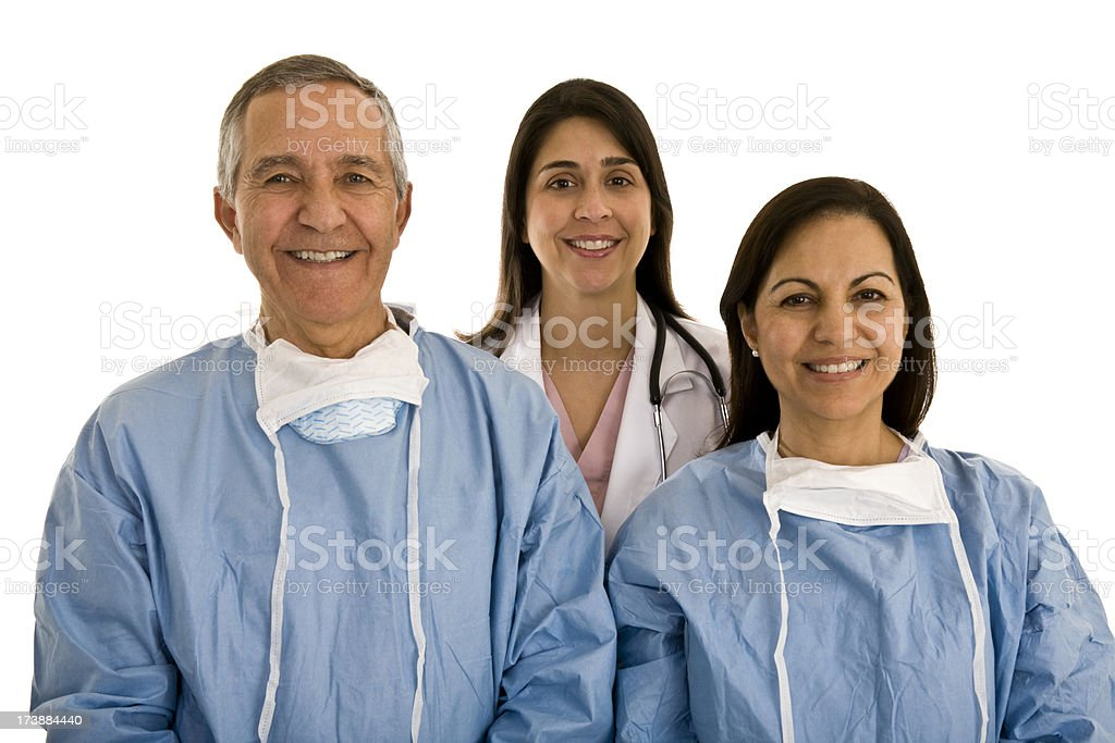 Two surgeons female and male with doctor in background royalty-free stock photo