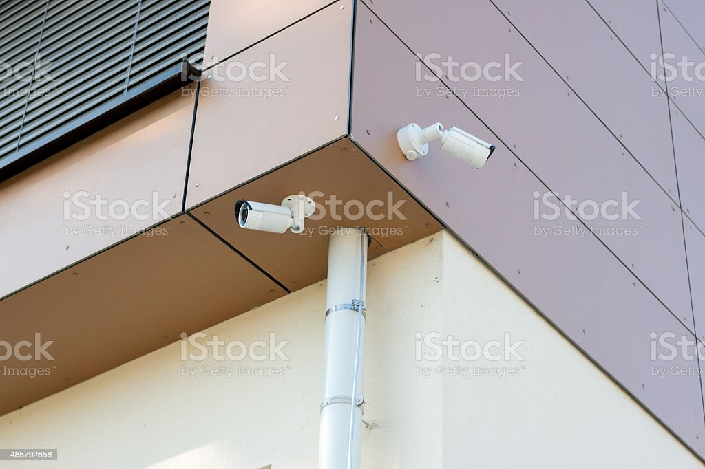Two Surveillance cameras on a modern building stock photo
