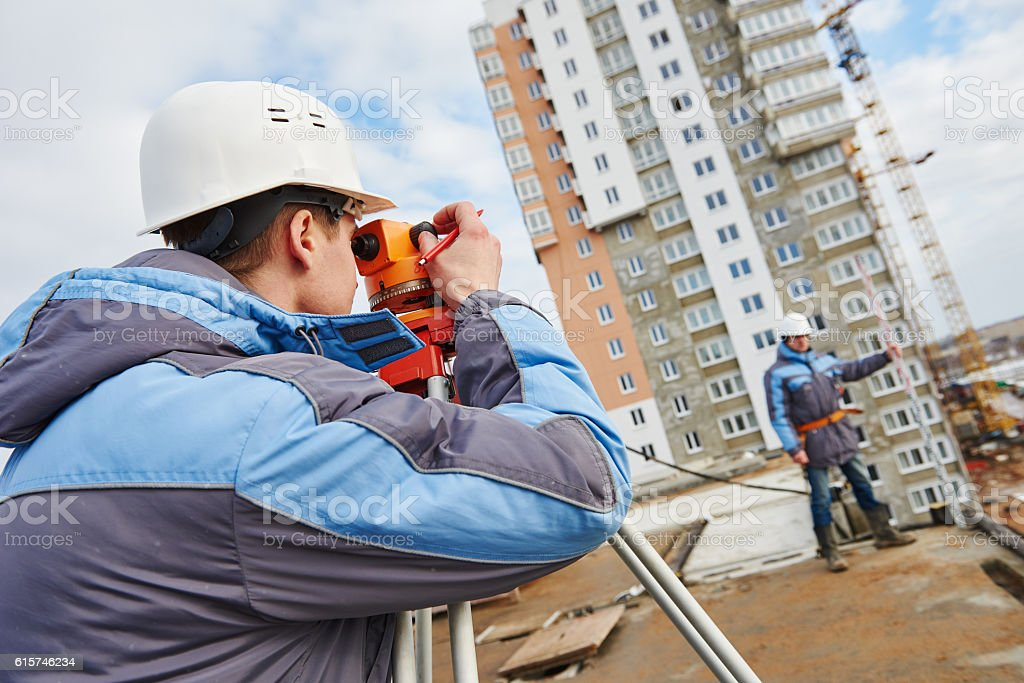 Two surveyors worker with theodolite stock photo