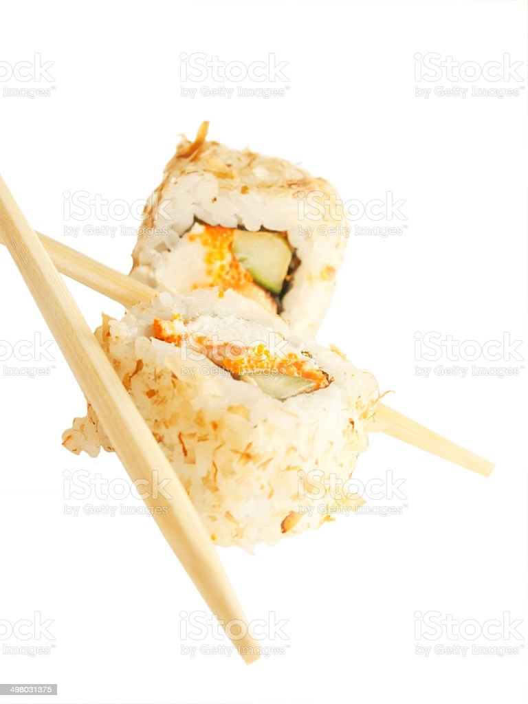 two sushi rolsl with tuna flakes and chopsticks over white royalty-free stock photo