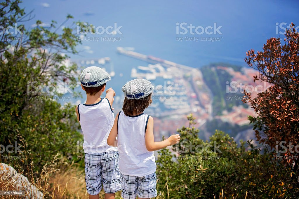 Two sweet boys, children watching the view of Monaco stock photo