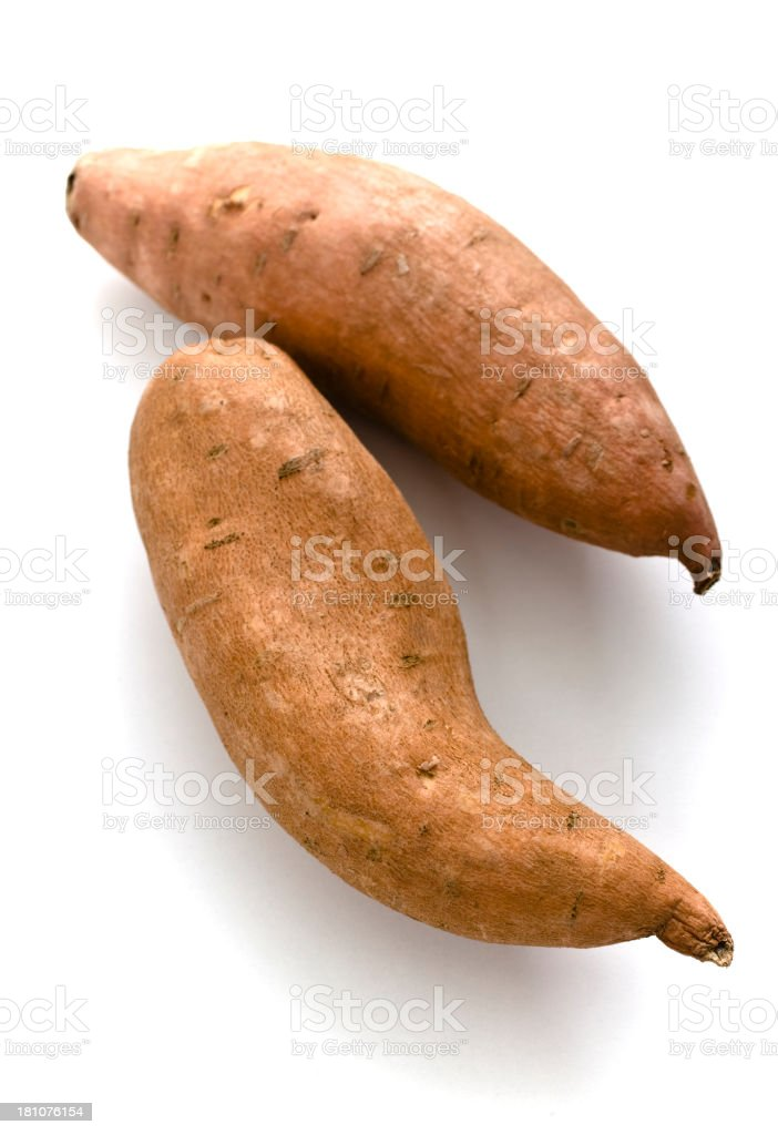 Two sweet potatoes against a white background royalty-free stock photo