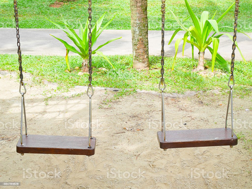 Two swings stock photo