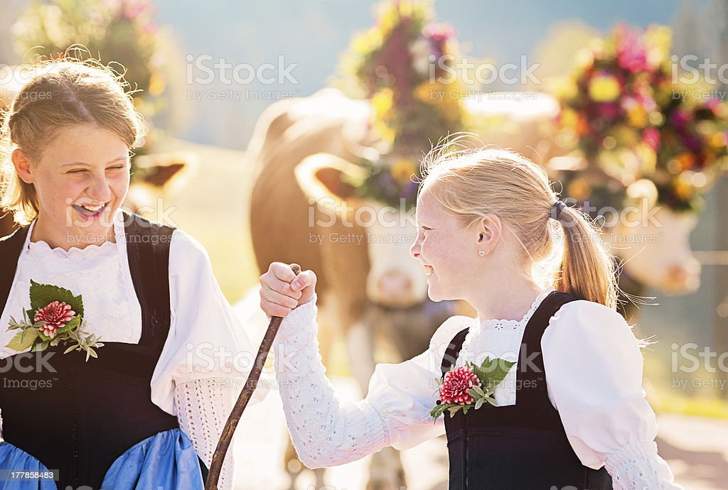 Two Swiss farmer girls having fun during Aelplerfest parade stock photo