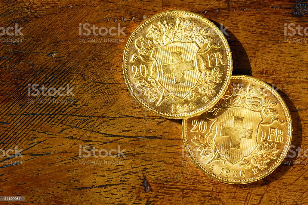 Two swiss gold coins stock photo