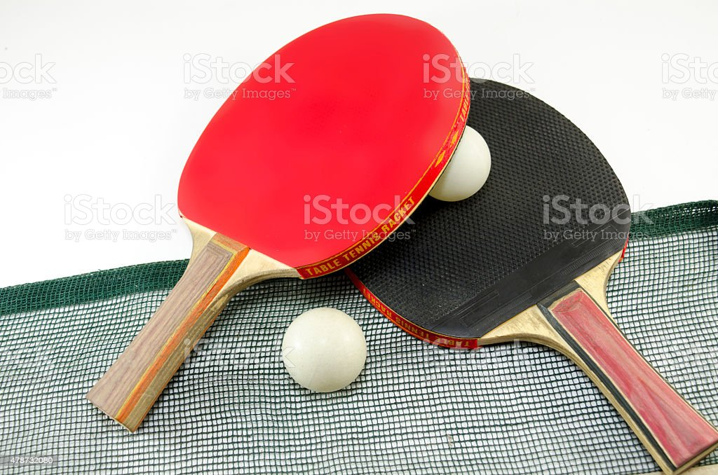 Two table tennis rackets and a net isolated stock photo