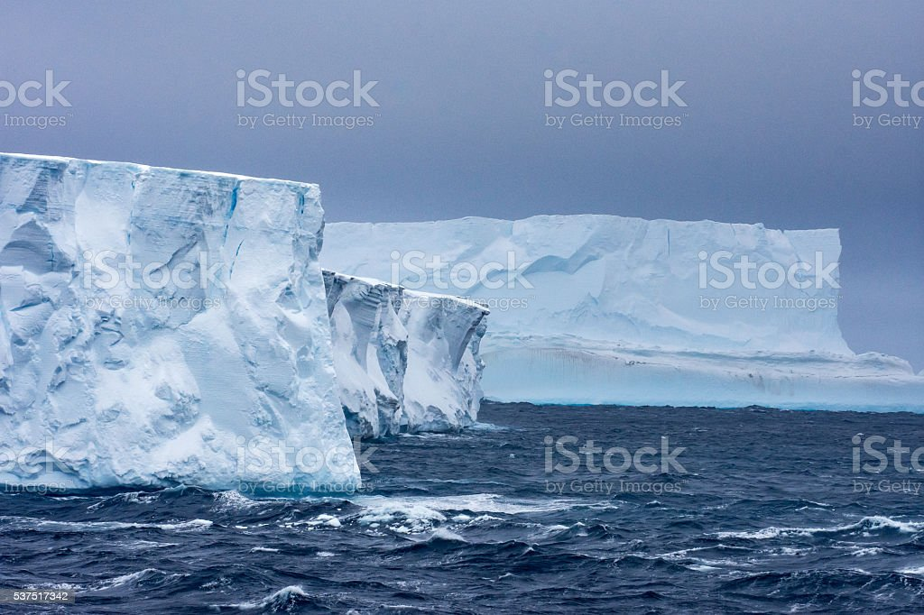 Two tabular icebergs in Antarctica stock photo