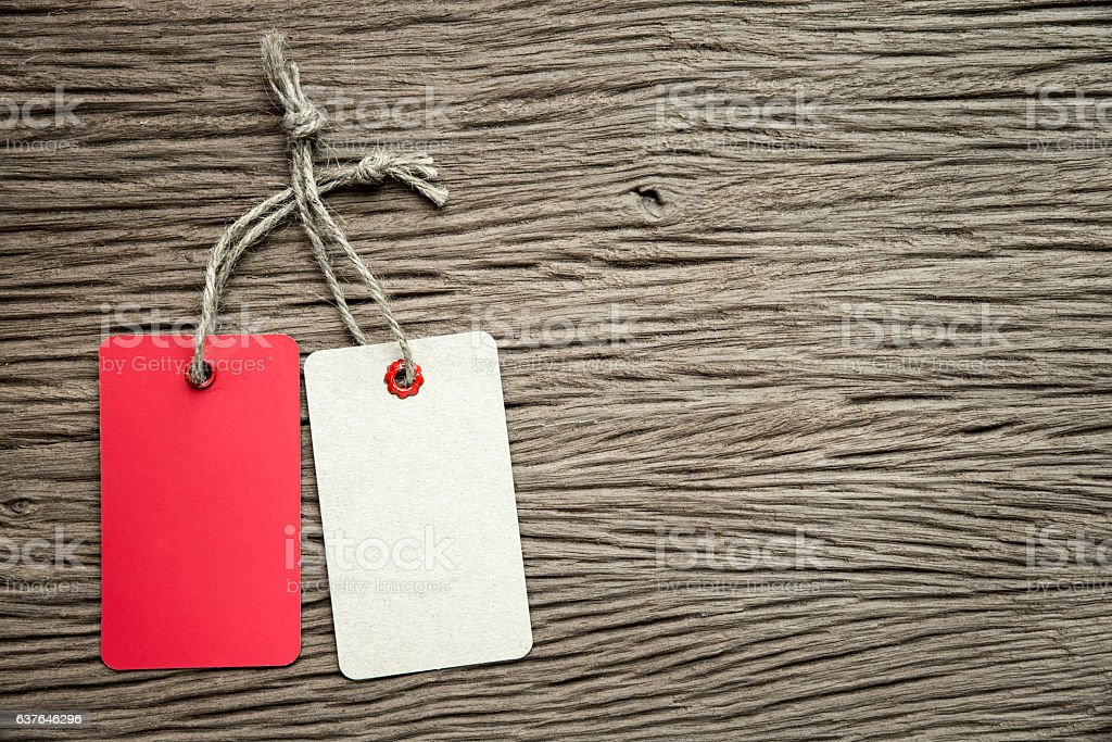 two tags on the wooden background. stock photo