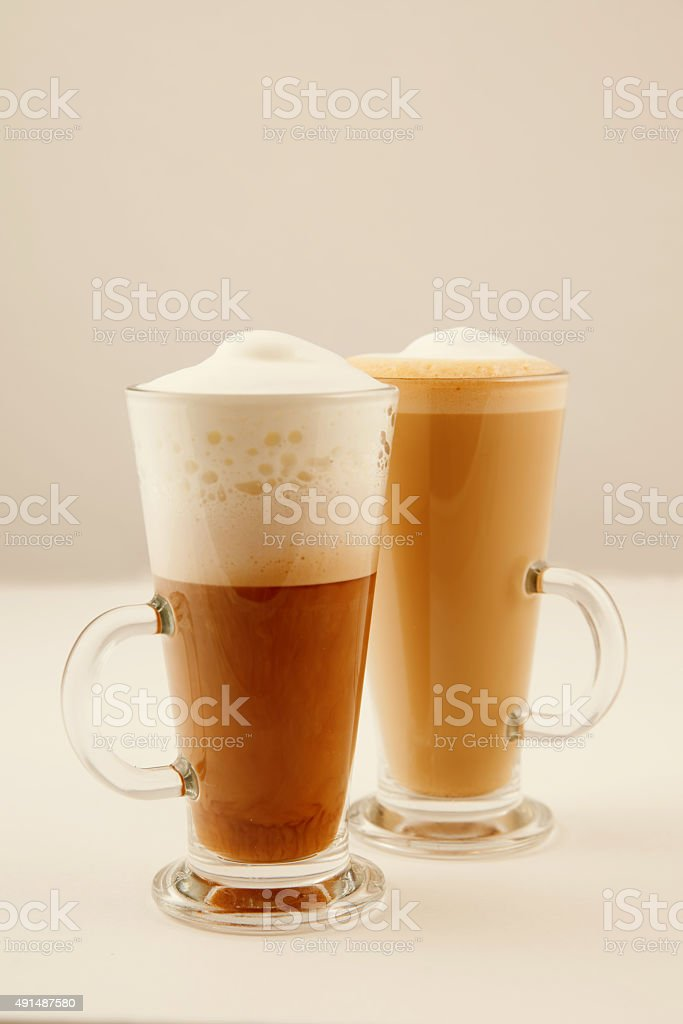 Two tall glass of coffee latte stock photo