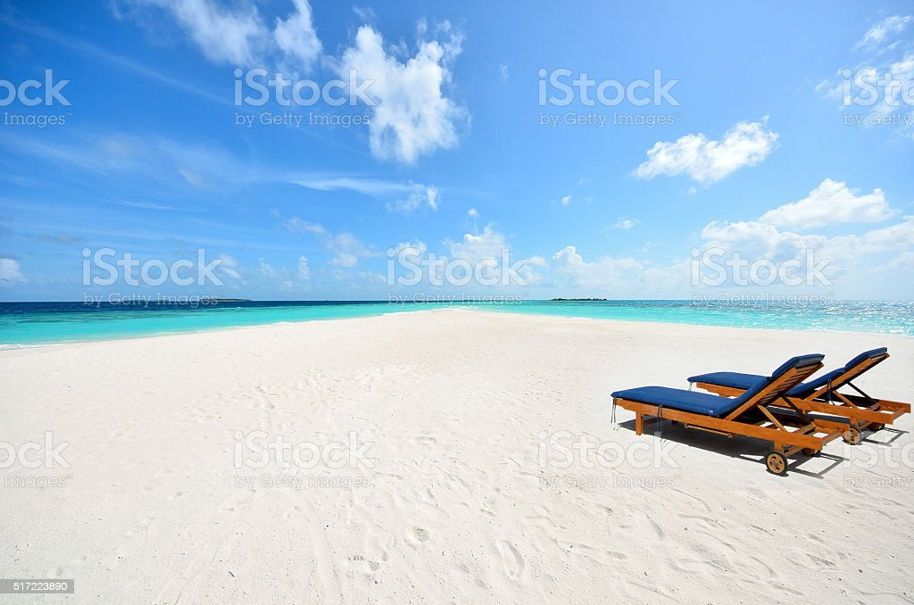 Two tanning beds at tropical sunny beach stock photo