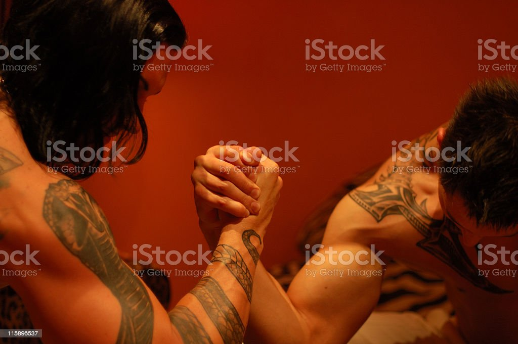 Two Tattooed Strong Men Armwrestling royalty-free stock photo