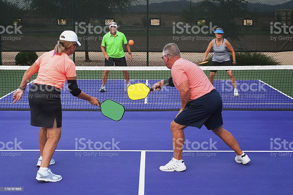 Two teams playing Pickleball stock photo