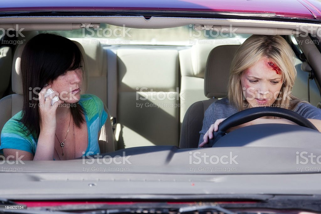 Two Teen Girls in Car After Accident stock photo