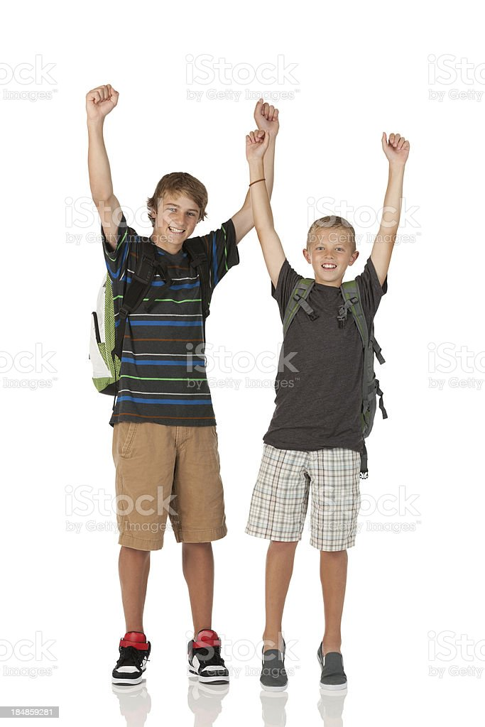Two teenage boys cheering royalty-free stock photo
