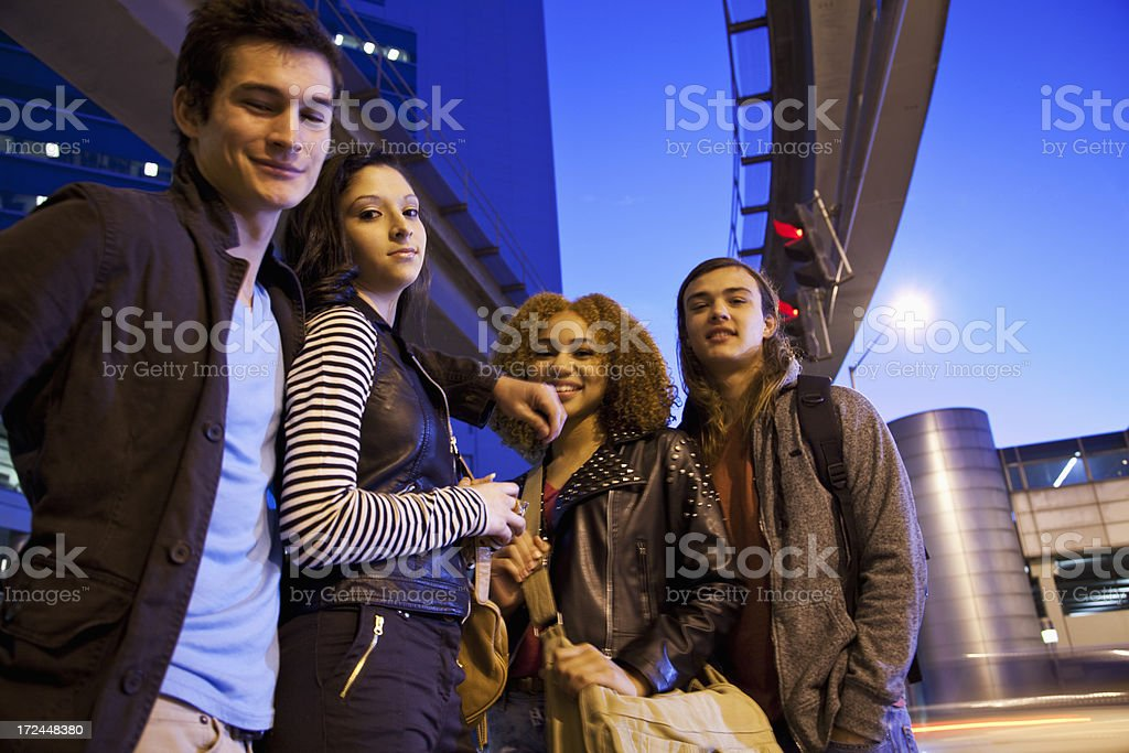 Two teenage couples in city stock photo