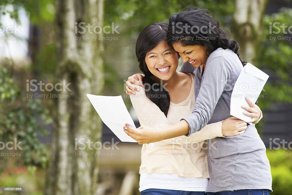Two Teenage Girls Celebrating Successful Exam Results stock photo