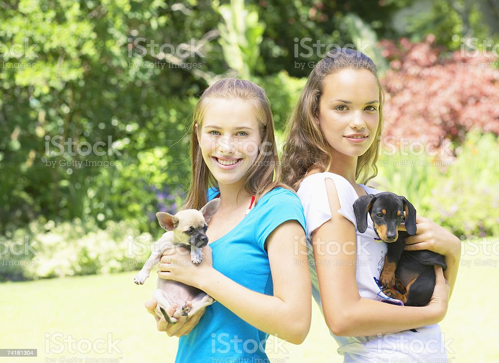 Two teenage girls with puppy dogs royalty-free stock photo