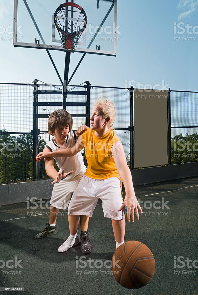 Two teenage players with basketball royalty-free stock photo