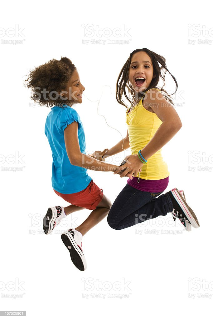 Two teenage young girls jumping mid air making face royalty-free stock photo