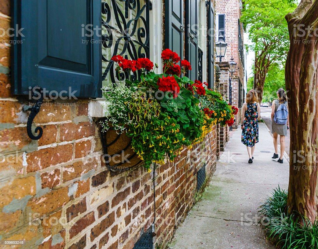 Two teenager girls on the street of Charlestone, South Carolina stock photo