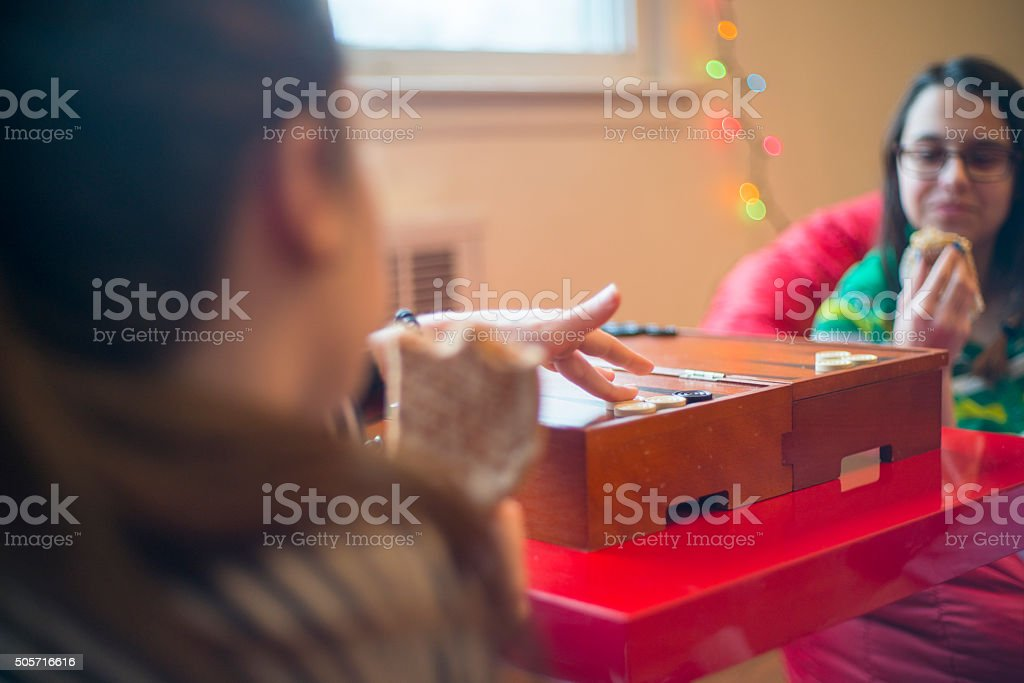 Two teenager girls playing backgammon stock photo