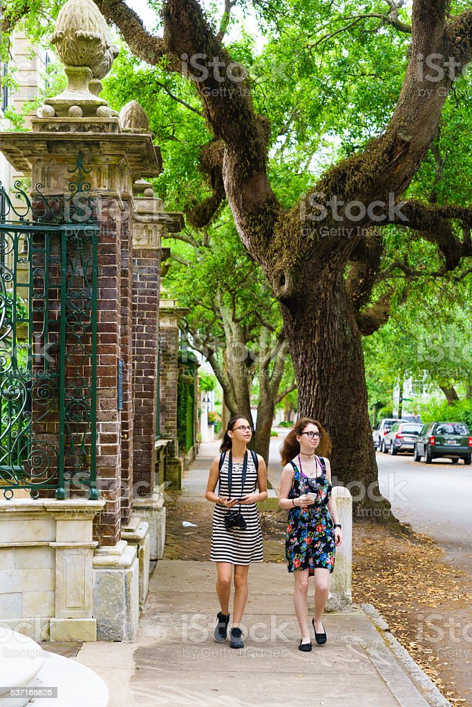 Two teenager girls walks on the street stock photo