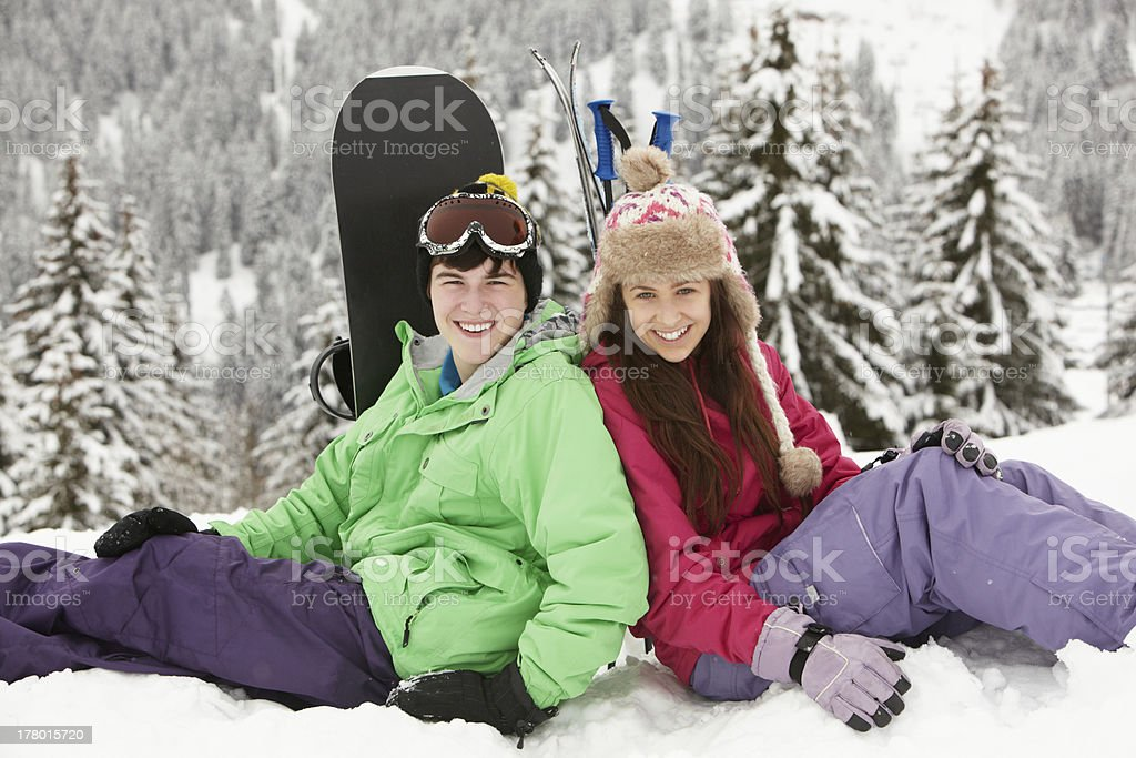 Two Teenagers On Ski Holiday In Mountains stock photo