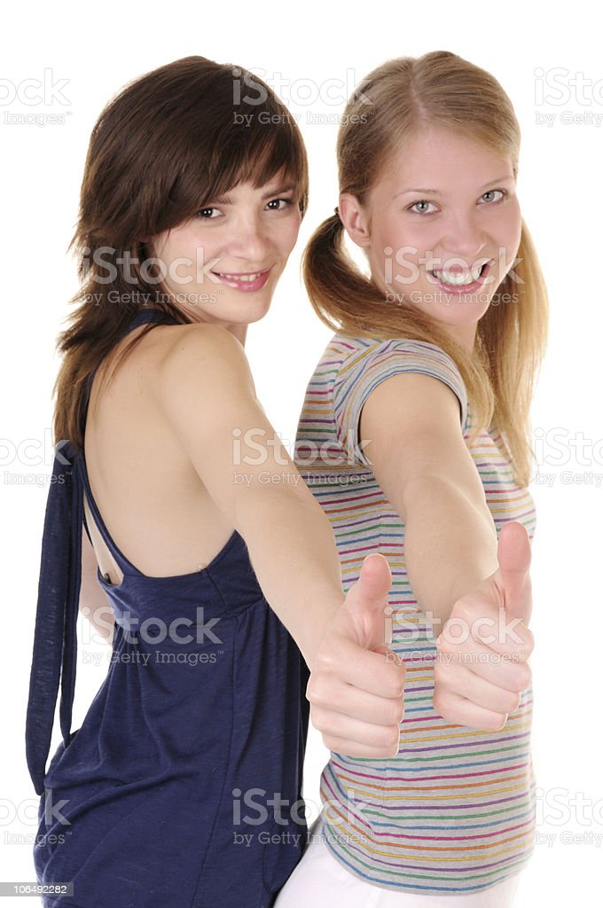 Two teenagers showing thumbs up. royalty-free stock photo