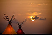 Two Teepees at Sunset