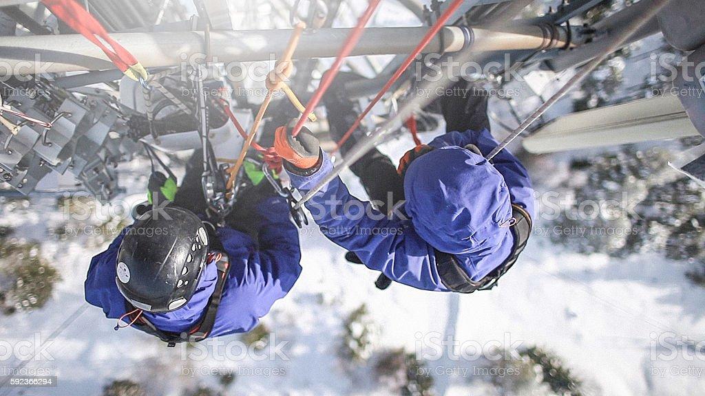 Two telecommunication manual high worker engineers repairing antenna stock photo