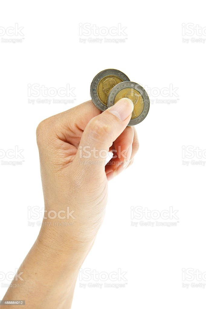 Two ten-baht coins with hand isolated on white background stock photo