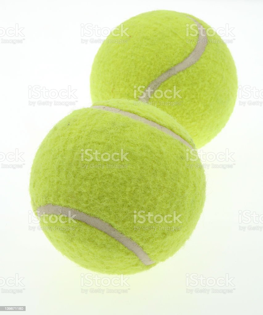 two tennis balls on white royalty-free stock photo