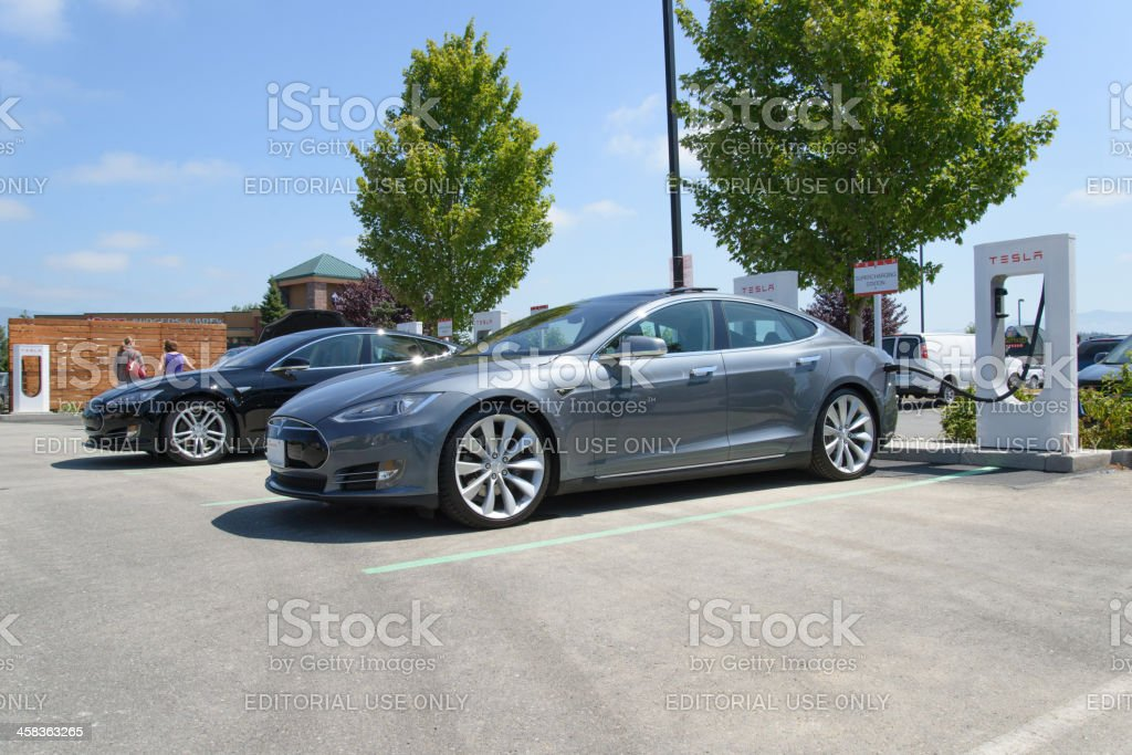 Two Tesla Motors Model S Charging At Burlington Washington Supercharger stock photo