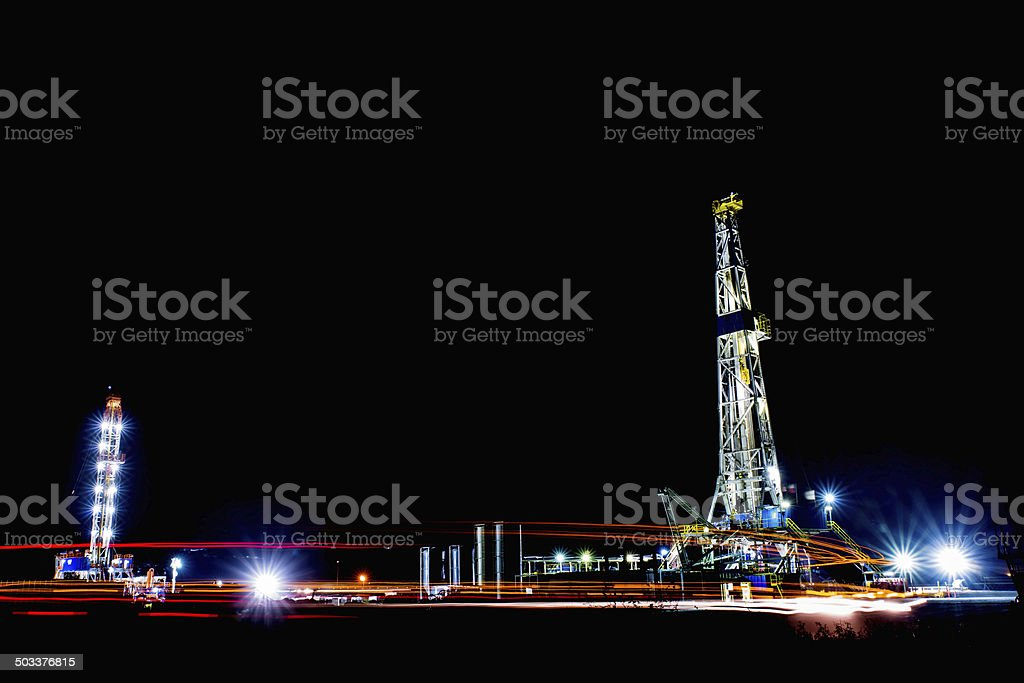 Two Texas Shale Oil Rigs at Night stock photo