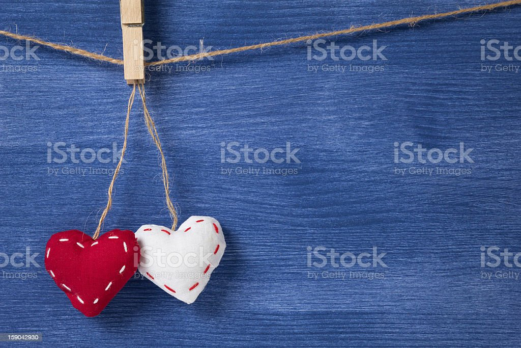 two textile hearts over wooden wall royalty-free stock photo