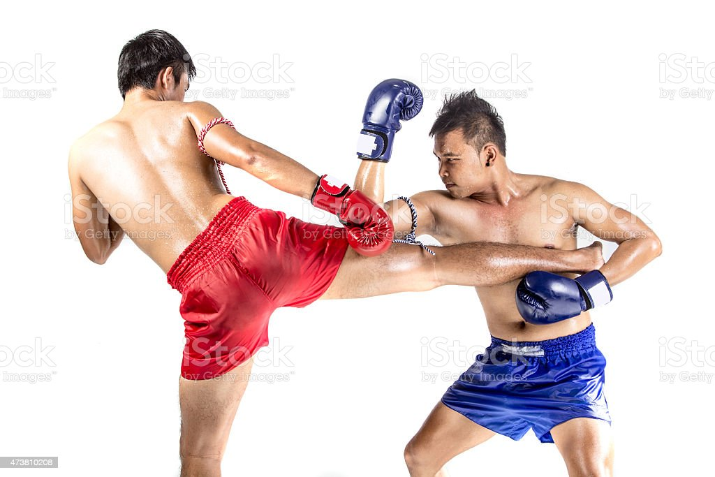 Two thai boxers exercising traditional martial art stock photo