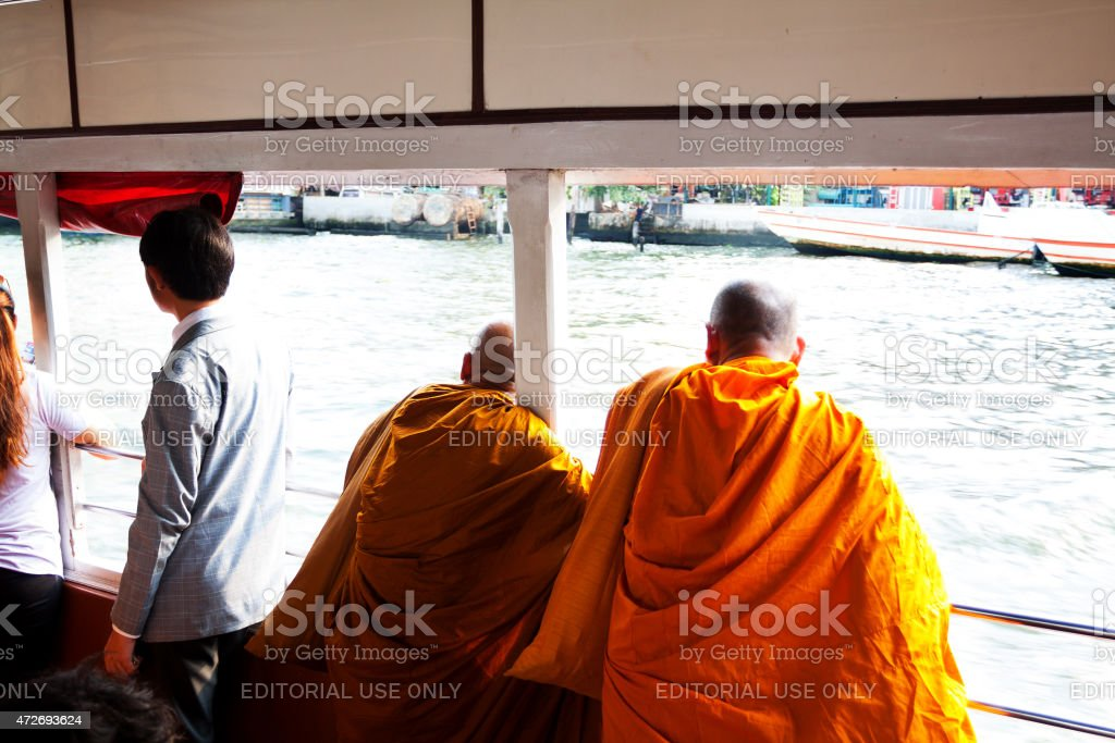 Two thai monks on taxi boat and Chao Praya stock photo