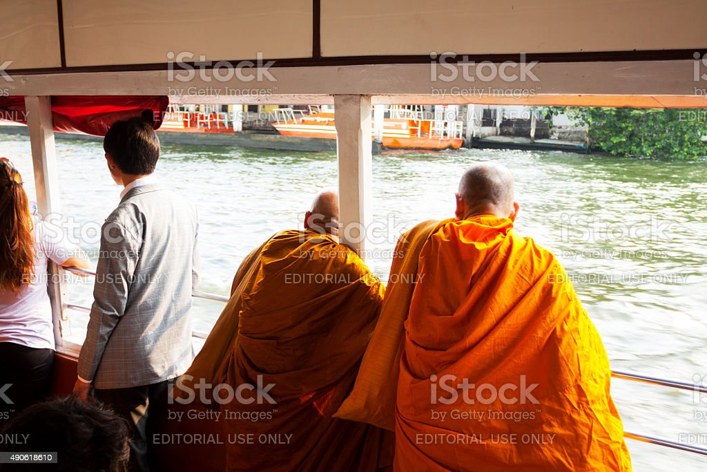 Two Thai monks on taxi boat stock photo