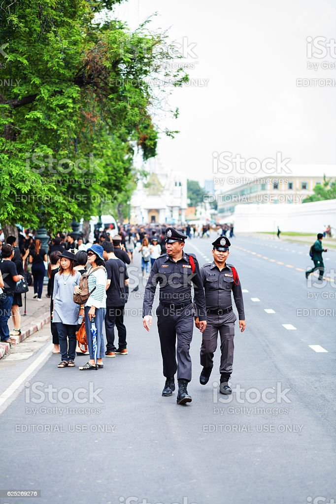 Two thai officers walking in front of Grand Palace stock photo