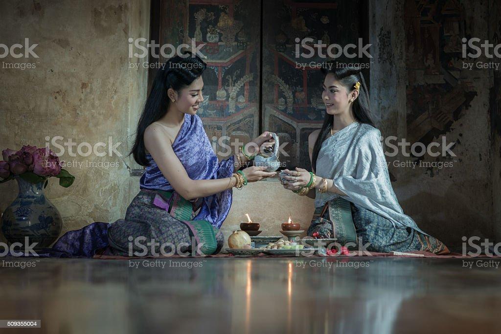 Two Thai woman wearing typical Thai dress. stock photo