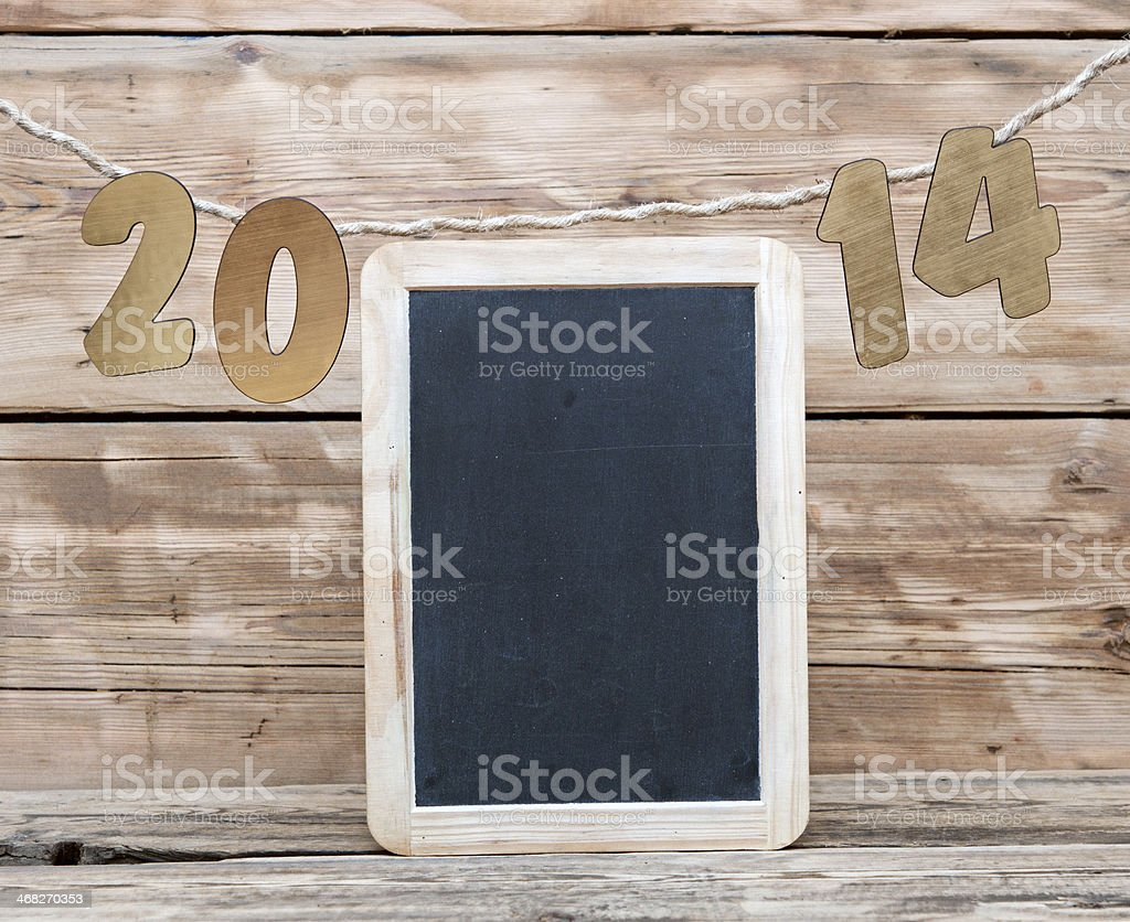 two thousand fourteen New Year number decoration hanging on rope stock photo