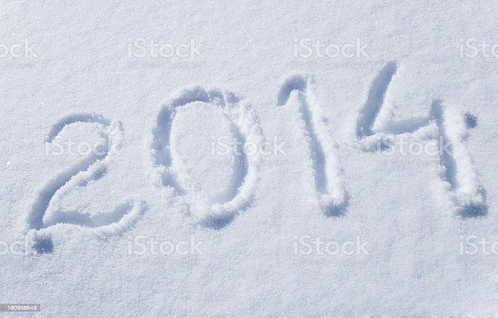 two thousand fourteen written in snow stock photo
