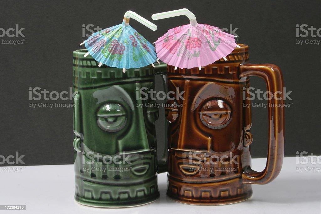 Two tiki mugs royalty-free stock photo