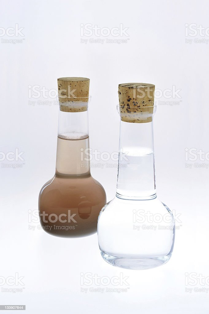 Two tiny samples of clean and dirty water royalty-free stock photo